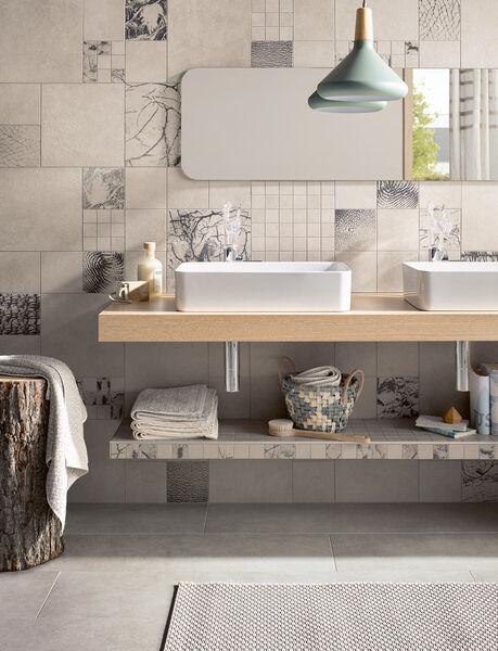 Grau ist nicht gleich Grau: Die Serie Thinsation von Steuler Fliesen überrascht in Wohn- und Badezimmern.