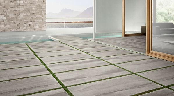 Del Conca Betonoptik Terrassenplatten begeistern mit modernen Oberflächen und Formaten! Im Bild: Del Conca Dogma2 Grigio, 60x120x2 cm.