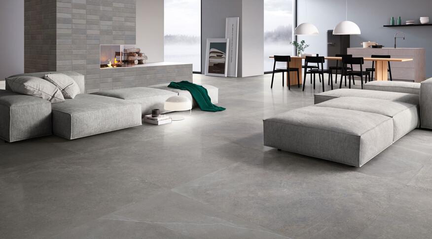 Schlichte und natürliche Raumgestaltung wird mit Steinoptik Fliesen wie Ceramicvision Evolution im Format 120x120cm und der Farbe Star möglich.
